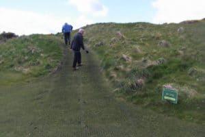 golfer standing on golf cart path